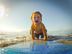 The picture we adore! by GoPro- photo of the day... Watch out Kelly Slater! GoPro Director of Media Production Wil Tidman's 2 year old son Quincy Blu enjoying the surf in Santa Cruz!