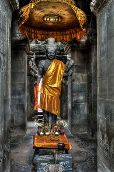 Lord Vishnu Statue in Gold costume Angkor Vat Temple, open on the west side, Vishnu is associated with the west. Vishnu is also one of the three main sects of Hinduism. Angkor Temple, Hindu Temple, Laos, Vietnam, Indian Gods, Indian Art, Sri Lanka, Indian Literature, Angkor Wat Cambodia