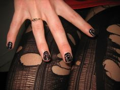 Fishnet tights nails.