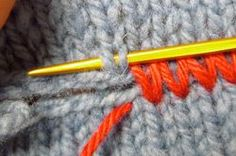 Knitting Tutorial - Matress Stitch worked horizontally to join two pieces of knitting. The stitches are in contrasting color to show detail, but I'd love to do this and add some embroidery for embellished seams on a sweater. from Knitting Daily.