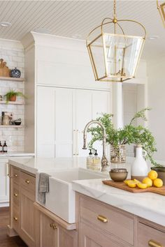 Traditional modern kitchen interior design with gold pendant light fixtures, wood island, white cabinets, and marble countertops - Studio McGee Kitchen Reno, New Kitchen, Kitchen Dining, Kitchen Remodel, Kitchen Cabinets, Gold Kitchen, Kitchen Sinks, Kitchen Island, Marble Kitchen Ideas