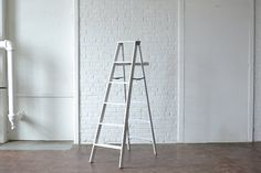 Large White Ladder: Wooden ladder painted white.  Can be used as architectural elements or for display shelving. *Paisley & Jade Vintage & Specialty Furniture Rentals for Events, Weddings, Theatrical Productions & Photo Shoots*