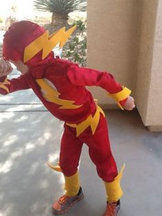 I used Simplicity Pattern 2567 to make my son a Flash costume. I used red polyester costume fabric for the actual suit. I used yellow felt with stiff interfacing for the lightening bolts on the...