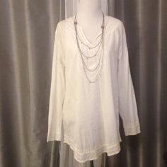 White Tunic With Beaded Trim Snowy white tunic with beautifully beaded neckline, sleeve and bottom trim. Fits long and loose, and will look great with leggings. Tag says small, but top fits closer to a medium/large. Wider arms slim at wrists. Tops Tunics