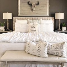 This rustic country master bedroom is perfect. I love the white farmhouse bedding, and tuft headboard. The faux bull head skull decor and diy shiplap is the cutest country western accent piece. Western Bedroom Decor, Western Rooms, Home Decor Bedroom, Bedroom Ideas, Rustic Chic Bedrooms, Rustic Chic Bedding, White Rustic Bedroom, Country Bedding, Western Chic