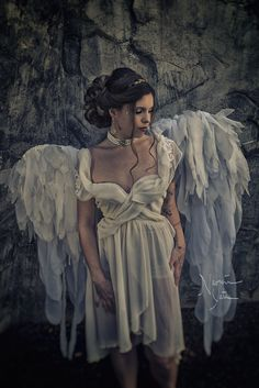 Fallen Angel Photoshoot. Elegant bride. Grecian bridal updo. Large curled chignon with braids and blonde extensions to add dimension. Boho, bohemian, Greek goddess style. Check out more of my work @hairartbynaomi on instagram. I'm in Raleigh, NC