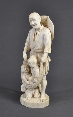 Large early Japanese carved ivory group. Fisherman with two children in net, and one at his feet. Signed to base. Some age cracking. Height 33 cm