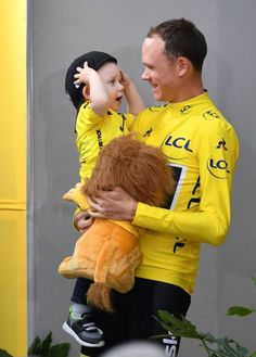 Team Sky rider Christopher Froome of Great Britain celebrates with his baby after winning the Tour de France 2017 cycling race at the Avenue des...