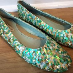 Rebels Multi green Sequin Flats Worn once and since then have been kept in the closet!  The soles of the shoe are in great shape.  They are in great condition.  Are a size 7 however there isn't a size shown on the inside or bottom of shoe.  Comes from a smoke free home Rebels Shoes Flats & Loafers