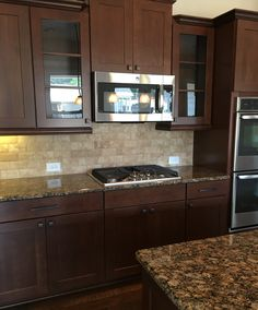 Kitchen Backsplash With Cherry Cabinets kitchen cabinets - american cherry, glass subway tile backsplash
