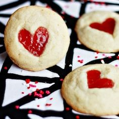 Heart Thumbprint Cookies. Vanilla bean cookies with a sweet strawberry jam center in a charming heart shape. Perfect for Valentine's Day!