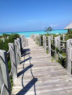 At the private island Parrot Cay, Parrot Cay Resort Vacation Destinations, Vacation Trips, Turks And Caicos, Garden Bridge, Parrot, Outdoor Structures, Island, Travel, Block Island