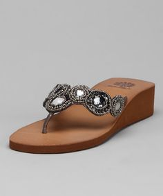 2419c283d Take a look at this Pewter Marcella Wedge Sandal by Vacation Getaway   Women s Footwear on