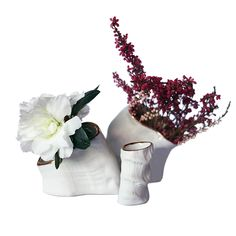 Handcast in porcelain at Beetle & Flor's New York studio, this set of three includes a small, medium and large bud vase.