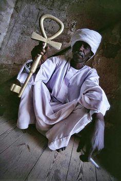 Ankh- Key of Life held by a Nubian man.