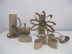 Toilet paper roll wall art... wrap gift  w string , ribbon.. place flower on top of Package
