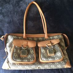 DOONEY & BOURKE TOTE BAG Authentic DOONEY and Bourke tote bag. Great condition only used once. 13x8x5 Dooney & Bourke Bags Totes