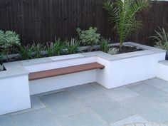 Urban Garden Design Kota Blue Limestone Paving used in an urban garden. The steel blue/grey colouring of the stone compliments the white rendering and wooden bench perfectly. Modern Garden Design, Contemporary Garden, Garden Paving, Garden Planters, Backyard Patio, Backyard Landscaping, Limestone Patio, Low Maintenance Garden Design, Planter Bench