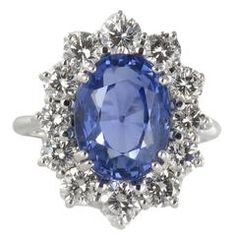 7.42 Carat Ceylon Sapphire Diamond Gold Ring.  An attractive daisy ring with a claw set exceptional oval Ceylon sapphire surrounded by 12 brilliant cut diamonds.   $62,963.38