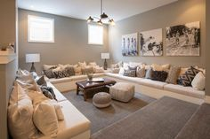 step down room with cream couches that run from wall to wall on three of the four walls with a coffee table and poufs in the center Modern Farmhouse Exterior, Modern Farmhouse Style, Barn House Plans, Basement Bedrooms, Bed Wall, Amazing Spaces, Basement Remodeling, Basement Ideas, Living Room Interior