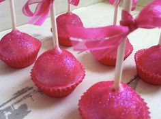 Pink Pops for Breast Cancer Awareness...this baking cup idea definitely solves my cake pop stand dilemma.