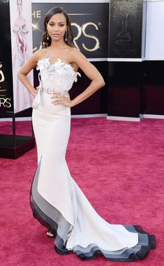 Zoe Saldana arrives at the 85th Annual Academy Awards, 2013, wearing a ultra-feminine belted Alexis Mabille gown. #oscars #redcarpet