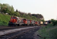 An eastbound CN freight train passes through Bayview Junction at Hamilton, ON on May 26, 1980, led by GP38-2 No. 5505.