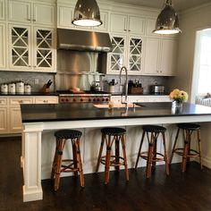 White kitchen with French bistro counter stools