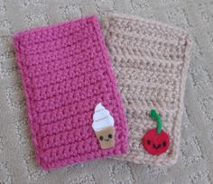 Cell phone cozies crocheted row by row with felted characters added!