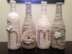These up cycled wine bottles are delicately wrapped in neutral colored yarn then adorned with buttons and flowers to say either HOME or LOVE. Each
