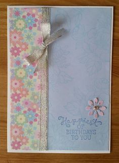 Simple card using papers & ribbon with a punched flower & stamped message