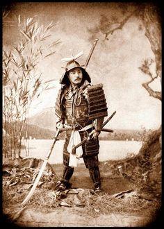 Samurai holding a long handled glaive (Naginata)