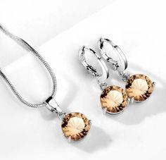 set bijuterii frumoase http://www.bijuteriifrumoase.ro/cumpara/set-bijuterii-cu-cristale-maro-3259