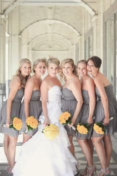 grey bridesmaids dresses with yellow flowers... So pretty but I was the flowers to be orange :)