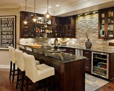 Basement bar -missing a TV and I don't love the bar itself, but I like the stone wall ...