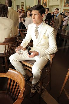 white suits are white suits, careful but I like the sitting classic pose