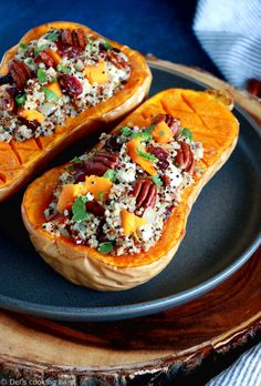 Delicious, healthy stuffed butternut squash with quinoa, cranberries, pecans and feta cheese. An easy, satisfying vegetarian fall dish! Seafood Recipes, Vegetarian Recipes, Cooking Recipes, Stuffing Recipes, Turkey Recipes, 21 Day Fix, How To Cook Squash, Roasted Butternut Squash, Base Foods
