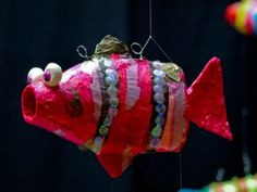 water bottle fish- I think we could paper mache this and then either paint or decoupage on tissue paper to decorate