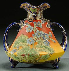 A NIPPON CORALENE DECORATED HANDLED/FOOTED VASE CIRCA 1909 WITH BEADED GLASS DECORATION OF FLOWERS ON BROWN SATIN FINISH WITH COBALT TRIM