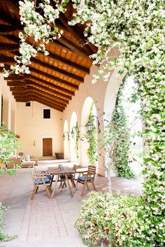 They have a completely enviable outdoor covered patio area, with blooming jasmine and Italian architectural features — and plenty of space for dog Millie to lounge when she's taking a break from playing.