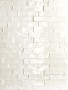 De Fazio Subway Handmade White tile love the way handmade tile glistens and you look into the glaze and see depth, instead of a flat white.