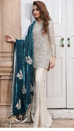 Make a statement this festive season in an all-silver outfit teamed with an embellished teal velvet shawl Pakistani Wedding Outfits, Pakistani Dresses, Indian Dresses, Indian Outfits, Dresses For Eid, Pakistani Party Wear, Pakistani Bridal, Bridal Lehenga, Party Dresses