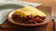 Bake a cornbread top on this simple chili, with mini-hot dogs and convenient canned baked beans flavored with barbecue sauce.