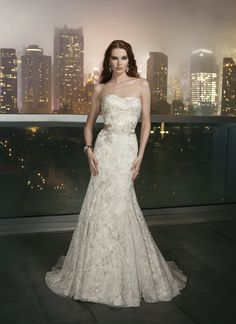 Justin Alexander signature wedding dresses style 9702 A modified sweetheart neckline on this mermaid in a beaded embroidered  tulle, a detachable Silk Dupion beaded belt, and a chapel length train  with buttons over the back zipper that finish at the drop waist. Belt  available as A030.