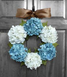 Elegant blue and white hydrangea wreath perfect for year round door decoration!  Several sizes and ribbon choices available.