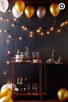 After the holiday craziness, cheers to a new year with an (almost) effortless cocktail party. Roll in a bar cart! Then, give it a totally festive feel with string lights at varying heights (don't put those Christmas lights away just yet!), and tuck gold, white and silver balloons into the layers.