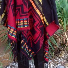 "HOST PICK 10/22/15Aztec Blanket Cape Black and Red with Turquoise, Orange and Olive Accent Colors. Reversible, 100% Acrylic, Measures 64"" X 52"", with Slit for Neck, 3.5"" Fringe, Fits S-L Jackets & Coats Capes"