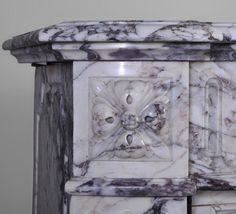 Sculpted Louis XVI rosette on a marble fireplace mantel #justarrived #shop #ruedesrosiers #violetmarble #LouisXVIstyle #frenchdecoration #haussmannarchitecture