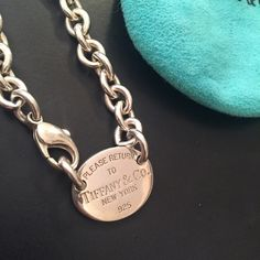 """Tiffany & Co. Sterling Silver Necklace Authentic sterling silver """"Return to Tiffany & Co.""""' choker. I have worn this several times but it remains is good condition. Please see pictures. Includes dustbag. No trades or PP. Posh rules. Reasonable offers welcome using offer button. (Offers at 50% off listing price will be declined). Final sale. Tiffany & Co. Jewelry Necklaces"""