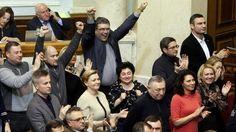BBC - Opposition memebers, including leader Vitaly Klitschko (top R) celebrate as parliament votes to remove President Viktor Yanukovych
